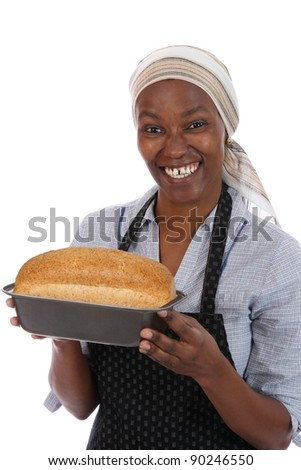 Happy smiling African woman with a freshly baked loaf of bread - stock photo