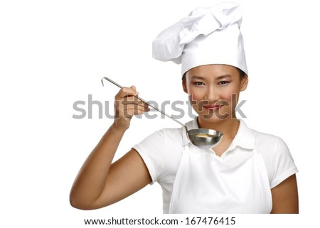 Happy smiling asian chinese woman chef at work on white