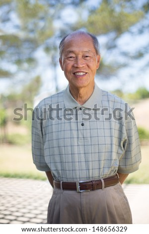 Happy Smiling Asian Senior Elderly Standing Outdoor - stock photo