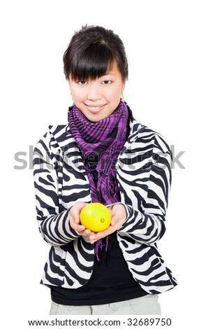 Happy smiling asian young woman hoding lemon - stock photo