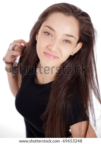 Happy smiling attractive young woman with dark long hair and blue eyes - stock photo