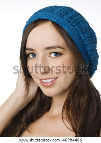 Happy smiling attractive young woman with pretty white smile wearing blue wool hat