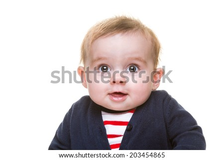 Happy Smiling Baby Girl in Blue Cardigan and Red Striped Top Isolated