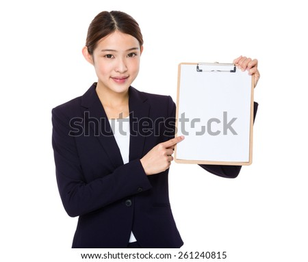 Happy smiling beautiful young business woman showing blank clipboard - stock photo