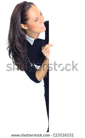 Happy smiling beautiful young business woman showing blank signboard, isolated over white background - stock photo