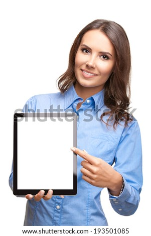 Happy smiling beautiful young business woman showing blank tablet pc for copyspace, isolated over white background - stock photo