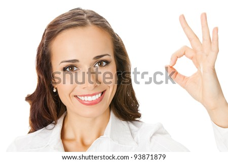 Happy smiling beautiful young business woman showing okay gesture, isolated over white background