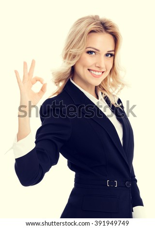 Happy smiling beautiful young businesswoman showing okay gesture - stock photo