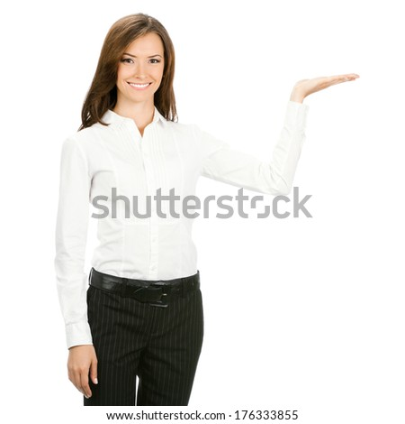 Happy smiling beautiful young cheerful business woma showing something, isolated on white background - stock photo