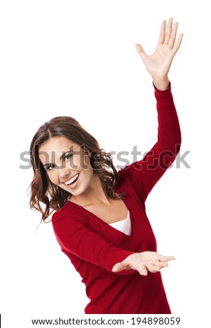 Happy smiling beautiful young woman carring, holding or showing something transparent or visual imaginary, isolated over white background - stock photo