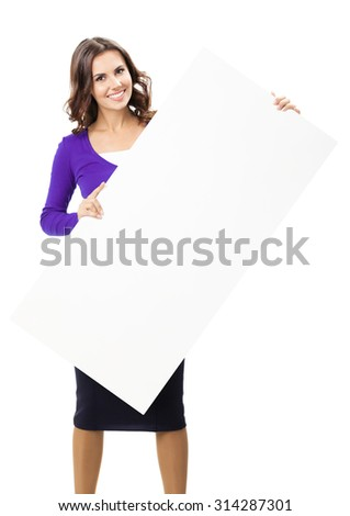 Happy smiling beautiful young woman, in violet casual clothing, showing blank signboard or copyspace for slogan or text, isolated over white background - stock photo