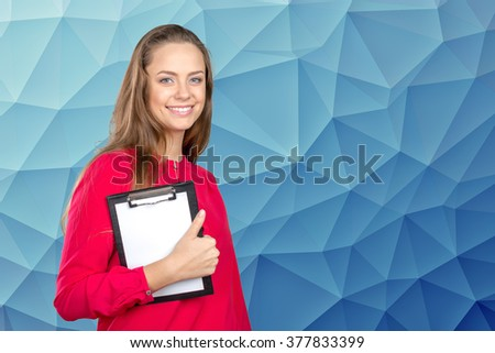 Happy smiling beautiful young woman showing blank clipboard