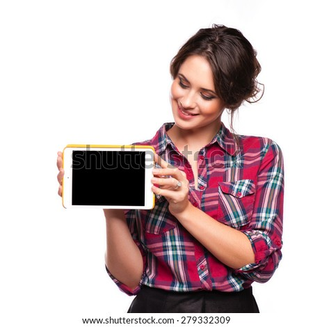 Happy smiling beautiful young woman showing blank tablet pc for copyspace, isolated over white background - stock photo