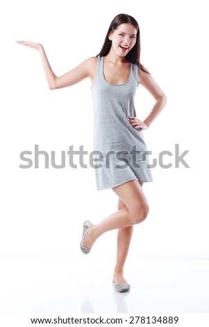 Happy smiling beautiful young woman showing copyspace or something - stock photo