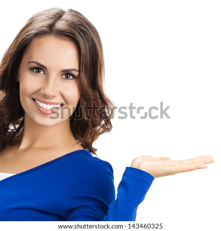 Happy smiling beautiful young woman showing copyspace or something, isolated over white background - stock photo
