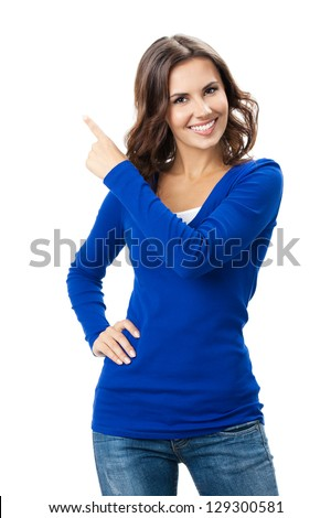 Happy smiling beautiful young woman showing copyspace, visual imaginary or something, or pressing virual button isolated over white background - stock photo