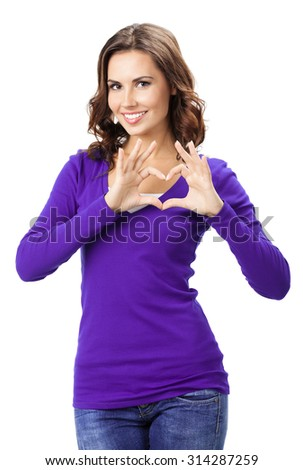 Happy smiling beautiful young woman showing heart symbol gesture, in violet casual clothing, isolated over white background - stock photo