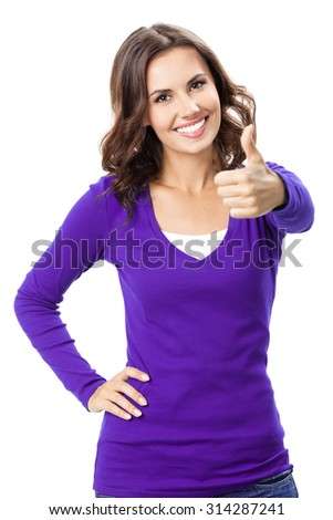 Happy smiling beautiful young woman showing thumbs up gesture, in violet casual clothing, isolated over white background - stock photo