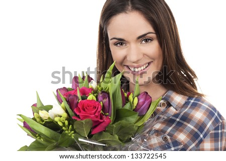 Happy smiling beautiful young woman with bouquet - stock photo