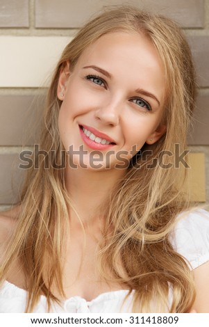 happy smiling blond girl portrait