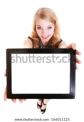 Happy smiling blond girl showing tablet white copyspace. Modern young woman holding tablet touchpad blank space. Technology communication. Isolated. Studio shot. - stock photo