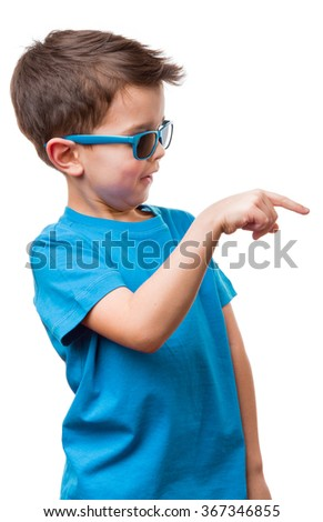 Happy smiling boy in blue t-shirt and sunglasses pointing finger, isolated on white background - stock photo