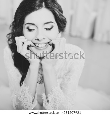 Happy smiling bride posing. Wedding portrait in black and white.  - stock photo