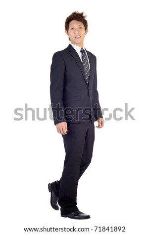 Happy smiling business man walking with smiling expression, full length portrait isolated over white background. - stock photo