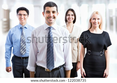 Happy smiling business team standing in a row - stock photo