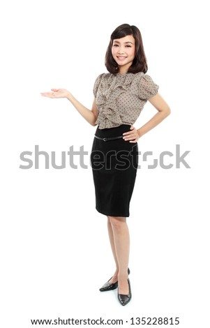 Happy smiling business woman in suit presenting copy space ready for your text