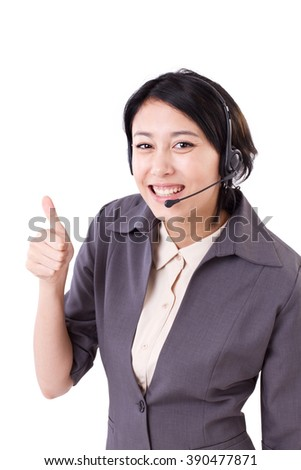 happy, smiling business woman showing thumb up gesture with headset - stock photo