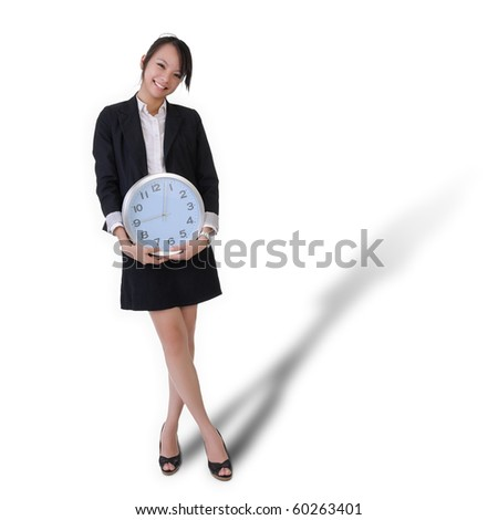 Happy smiling business woman with clock, time concept with full length portrait isolated on white background. - stock photo