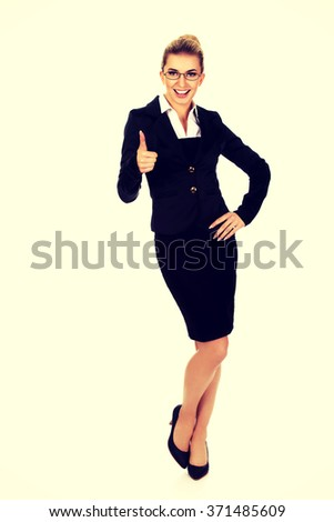 Happy smiling business woman with ok hand sign - stock photo