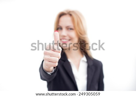 Happy smiling business woman with thumbs up gesture. Selective focus.  - stock photo