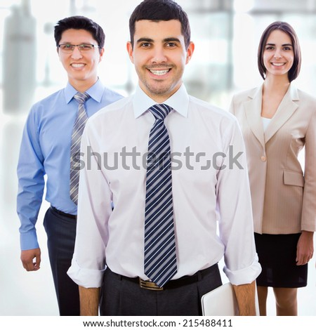 Happy smiling businessman and his collegues - stock photo