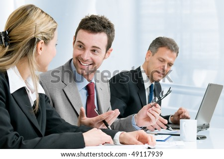 Happy smiling businessman cheering at new success with his business team at office - stock photo