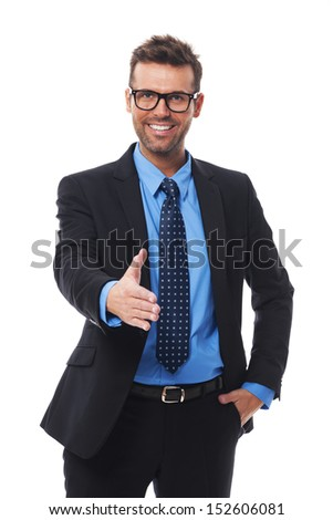 Happy smiling businessman giving hand for an handshake - stock photo