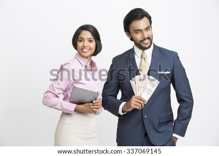 Happy smiling businessman holding money with his colleague on white background. - stock photo