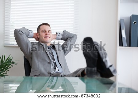 Happy smiling businessman taking a rest