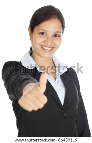 Happy smiling businesswoman showing thumbs up