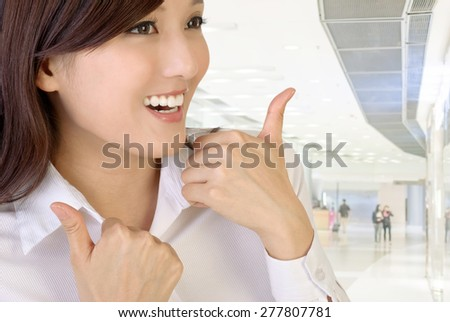 Happy smiling businesswoman with gesture. - stock photo