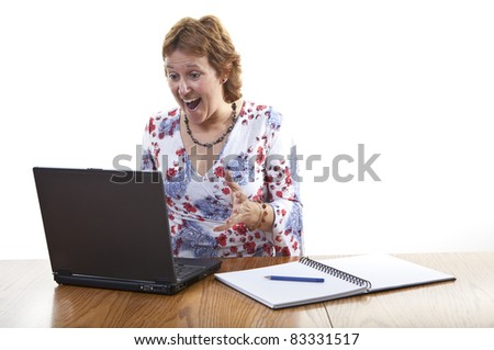 Happy Smiling Businesswoman working on a laptop - stock photo