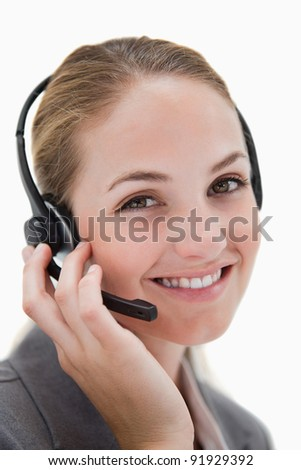 Happy smiling call center agent at work against a white background - stock photo