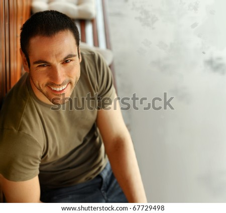 Happy smiling casual guy smiling outdoors