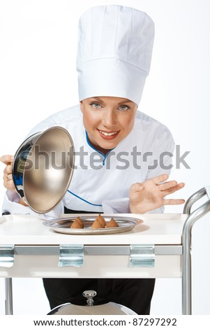 happy smiling caucasian female chef introducing new dish - stock photo
