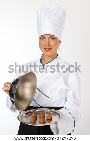 happy smiling caucasian female chef introducing new dish - stock photo