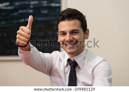 Happy Smiling Cheerful Business Man With Thumbs Up Gesture - stock photo