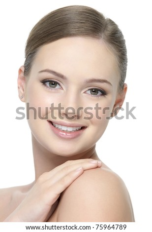 Happy smiling cheerful face of young beautiful woman isolated on white background - stock photo