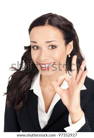 Happy smiling cheerful young business woman showing okay gesture, isolated over white background