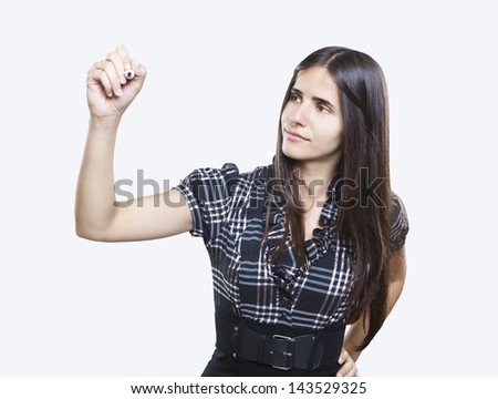 Happy smiling cheerful young business woman writing or drawing on screen with a marker, isolated on white background - stock photo